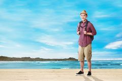 Handsome asian tourist man with backpack standing royalty free stock images