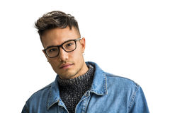 Handsome asian-white young man wearing grey sweater. Handsome white asian young man wearing blue denim jacket, standing isolated on white background in studio Royalty Free Stock Photos