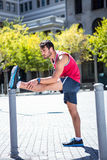 Handsome athlete doing leg stretching on a stake Royalty Free Stock Photo