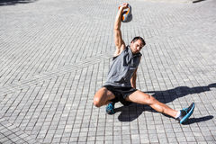 Handsome athlete exercising turkish get up Stock Photo