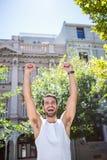 Handsome athlete gesturing victory Stock Image