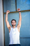 Handsome athlete gesturing victory Stock Images