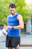 An handsome athlete holding a bottle Stock Photo