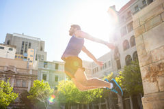 Handsome athlete jumping Stock Photography