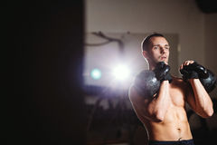 Handsome athlete with Kettlebell Stock Photography