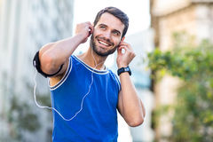 An handsome athlete listening to music Stock Photography