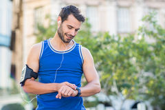An handsome athlete looking at the time Royalty Free Stock Photography