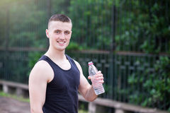 Handsome athlete man drinking water Royalty Free Stock Photography