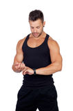 Handsome athlete measuring your pulse Royalty Free Stock Photos