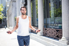 Handsome athlete skipping with jump rope Stock Photos