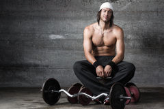 Handsome athlete smiling. Handsome muscular athlete smiling and looking at camera Royalty Free Stock Photo