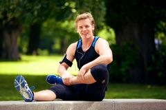 Handsome Athlete Stretching His Legs Stock Photography