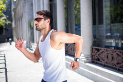 Handsome athlete with sunglasses jogging Stock Photo