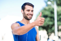 An handsome athlete thumbs up Royalty Free Stock Photos