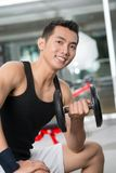 Handsome athlete. Vertical portrait of a handsome athlete working out with a dumbbell Stock Image