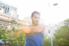 Handsome athlete warming up Royalty Free Stock Images