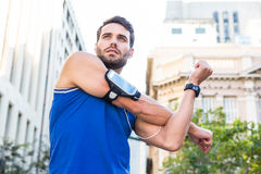 Handsome athlete warming up Stock Photo