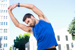 Handsome athlete warming up Royalty Free Stock Image