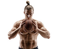 Handsome athletic basketball player with a ball. Stock Image