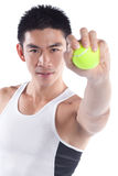 Handsome athletic chinese sportsman, tennis ball. Studio portrait of handsome athletic chinese sportsman holding tennis ball , looking into camera Royalty Free Stock Photos