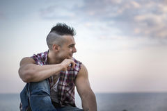 Handsome Athletic Man Looking Away Against Sky Stock Photo