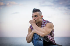 Handsome Athletic Man Looking Away Against Sky Royalty Free Stock Images