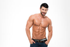 Handsome athletic man with naked torso. Portrait of a handsome athletic man with naked torso standing isolated on a white background Stock Images
