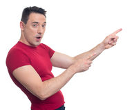 Handsome athletic man pointing at text area Stock Photos