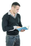 Handsome athletic man reading book dressed elegant Stock Photography