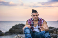 Handsome Athletic Man by Sea Shore or Ocean Royalty Free Stock Photography