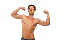 Handsome Athletic man showing muscles isolated Stock Photos