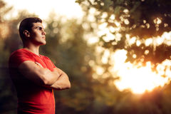 Handsome Athletic Man Standing Outside in Nature Royalty Free Stock Image