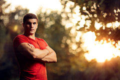 Handsome Athletic Man Standing Outside in Nature Royalty Free Stock Photos