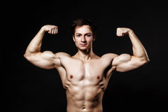 Handsome athletic man. Strong bodybuilder with six pack, perfect. Abs, shoulders, biceps, triceps and chest. Great fitness body. Ideal for commercial Stock Images