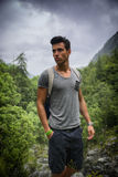 Handsome athletic young man with backpack in mount Royalty Free Stock Photo