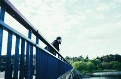 Model man on bridge royalty free stock photos