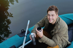 Handsome attractive man on the boat at the lake, lifestyle Stock Images