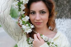 Woman smell tree flower Stock Photo