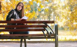 Fashion young girl read book bench royalty free stock image