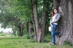 Woman in tree park outdoor. Handsome and attractive person in summer strolls through the city streets stock images