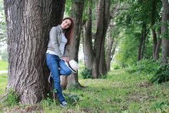 Woman in tree park outdoor. Handsome and attractive person in summer strolls through the city streets stock image