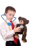 Handsome attractive young boy dressed as a Doctor-. In suit with stethescope looks off to his bright future on white background royalty free stock photos