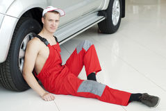Handsome Auto mechanic near a car Stock Photo