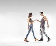 Handsome b-boy dancing with a slim girl Stock Photography