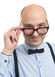 Handsome bald guy with suspenders and bow-tie Stock Photography