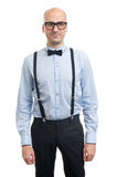 Handsome bald guy with suspenders and bow-tie Royalty Free Stock Photography