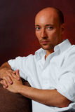 Handsome bald guy white shirt. Thinking Royalty Free Stock Photos