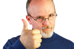 Handsome bald man with goatee looking over glasses Stock Images