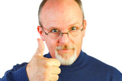 Handsome bald man with goatee looking over glasses Royalty Free Stock Photo