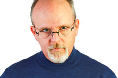 Handsome bald man with goatee looking over glasses Stock Photos